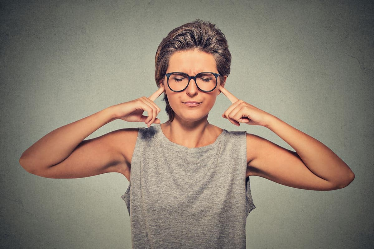 45719009 - woman plugging ears with fingers doesn't want to listen eyes closed ignoring stressful unpleasant situation conflict